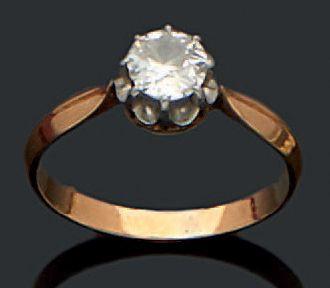 Bague en or jaune 18K (750) sertie d'un diamant...