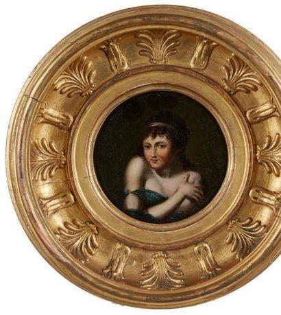 Miniature circulaire figurant le portrait d'une jeune femme pudique. Cadre en bois...