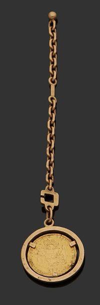Porte clef en or jaune 18K (750) orné d'une...