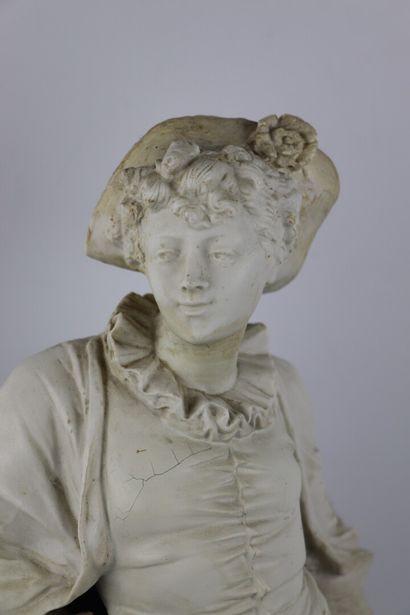 Ecole française du XIXème siècle.  Jeune élégant au chapeau.  Plâtre patiné, sur...
