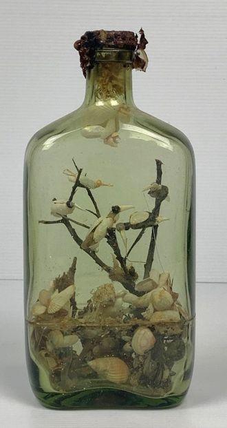 Bouteille en verre contenant une composition...