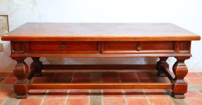 Table basse en bois mouluré ouvrant à deux...