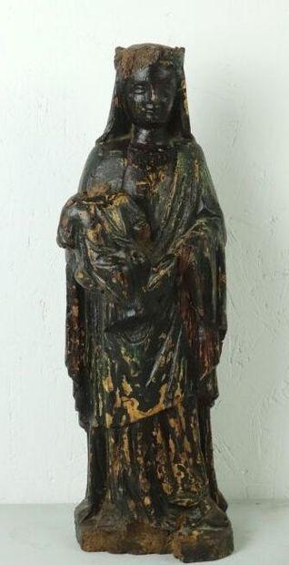 Vierge à l'enfant en bois sculpté polychrome....
