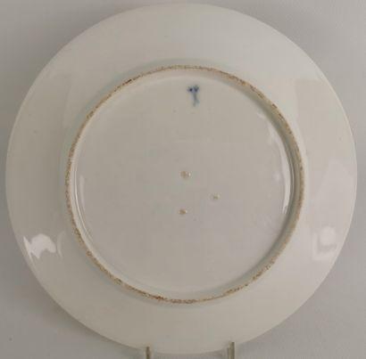 PARIS, manufacture de Locré.  Assiette en porcelaine à décor polychrome d'un turc...