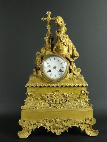 Pendule en bronze doré à décor d'une jeune...