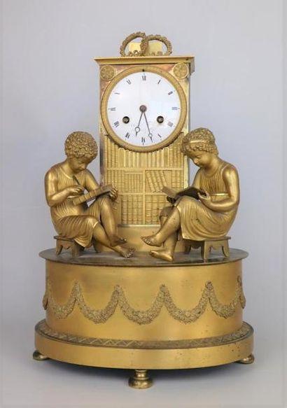 Pendule à la bibliothèque en bronze doré,...