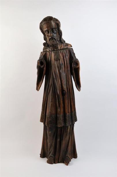 Grande statue en bois sculpté figurant un...