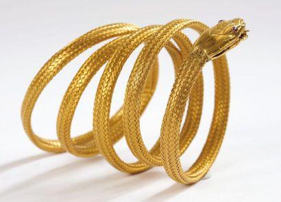 BRACELET souple «serpent» en or jaune à cinq...