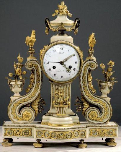 Pendule en marbre blanc et bronze ciselé...
