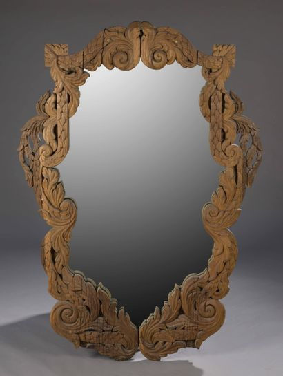 A large MIRROR in natural wood carved with...