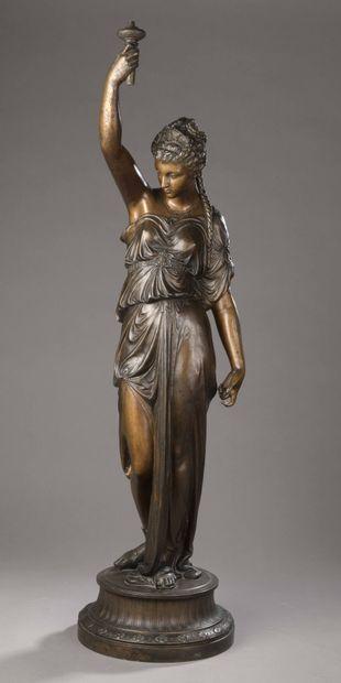 A regula torchbearer, representing a woman...