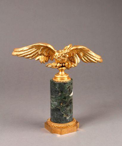 A green marble COLUMN surmounted by an eagle...