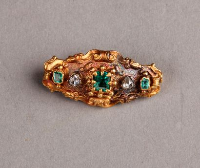 Antique oval brooch set with three emeralds...