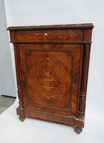 A chest of drawers with a door in rosewood...