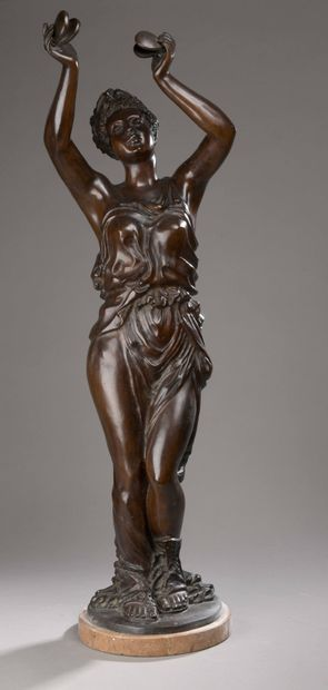 Bronze SUBJECT with brown patina representing...