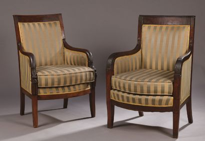 TWO mahogany veneered armrests with gadroons...
