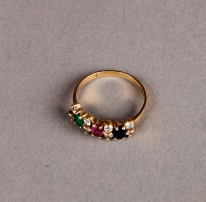 RING set with a line of sapphire, ruby and...