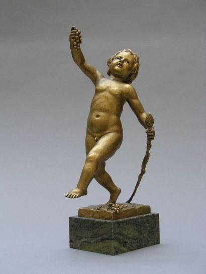 BACCHUS enfant en bronze doré, terrasse rectangulaire....