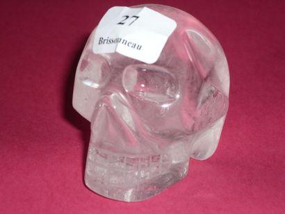TÊTE DE MORT en cristal de roche poli. H....