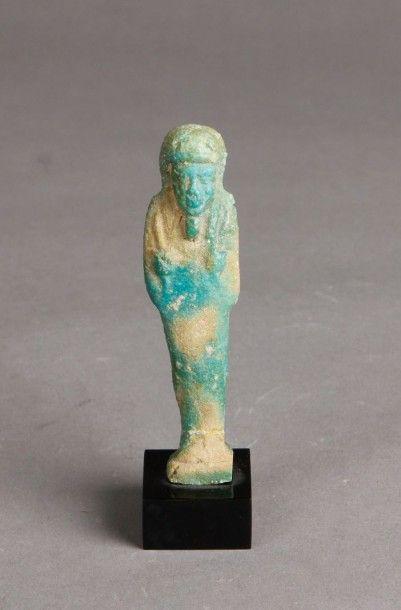 Oushebti d'époque Ptolémaïque en fritte émaillée....