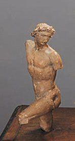 Statuette en terre cuite représentant un...