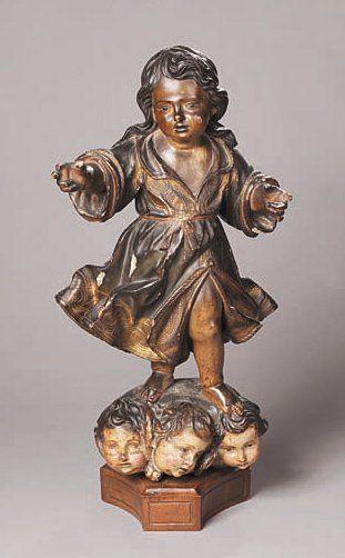 Statuette de l'Enfant Jésus en bois sculpté...