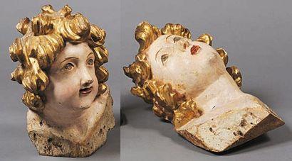 Paire de têtes d'anges en bois sculpté et...