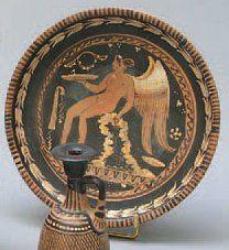 ASSIETTE en céramique peinte d'une ménade...