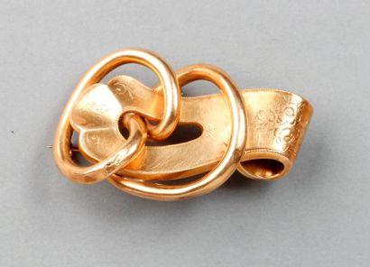BROCHE ancienne en forme de boucle en or...