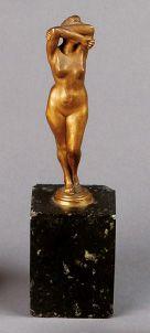 CACHET en bronze représentant une femme nue...