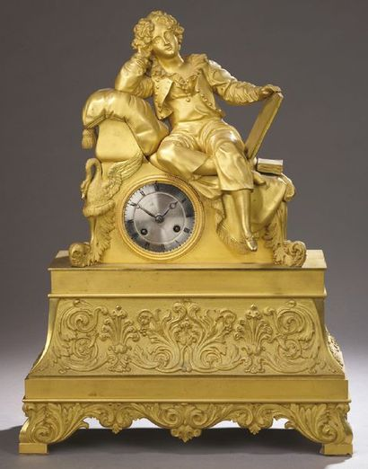 PENDULE en bronze doré à décor d'un jeune...