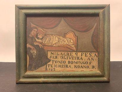 Ex-voto, huile sur bois figurant une femme auprès de son mari alité. Datée 1882....