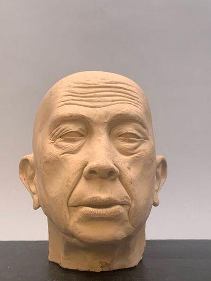 Moulage à tête d'homme. Haut. 23 cm