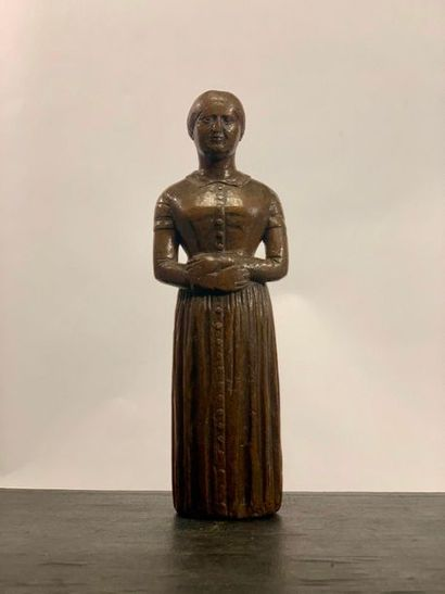 Statue en bois représentant une femme en...