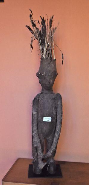 STATUETTE de personnage en bois et textile...