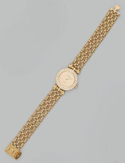 Montre bracelet de dame en or jaune à boîtier...