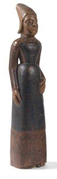 Statuette d'une normande en tablier et coiffe,...
