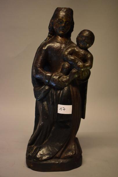 Statue Vierge à l'enfant. En bois peint....