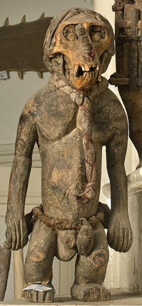 Statuette en bois représentant un singe dont...