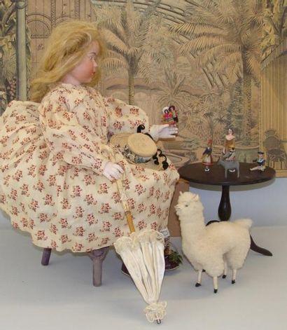 Le jardin d'hiver : poupée avec tête en biscuit...
