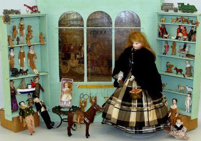 Magasin de jouets : poupée avec tête et buste...