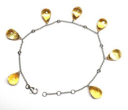 Bracelet en or blanc orné par 7 citrines...