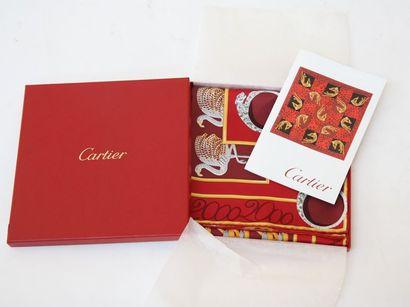 Un foulard Cartier Dans son coffret d'origine,...