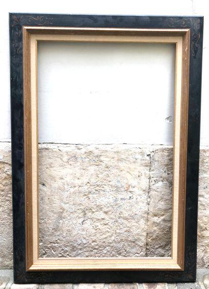 DEUX CADRES en bois noirci à décor peint...