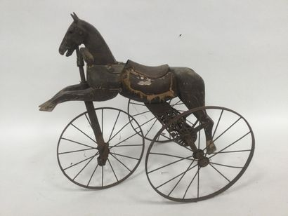Wooden wheel horse on a pedal wheel, early...