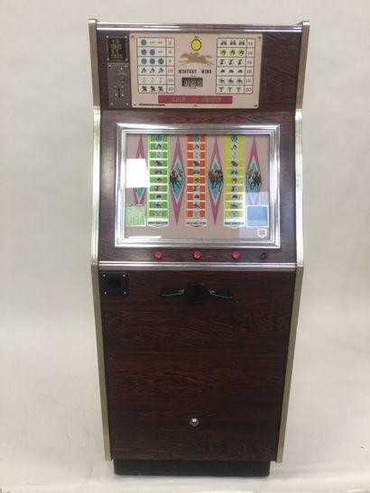 MYSTERY WINS GOLD JOCKEY 1973 slot machine...