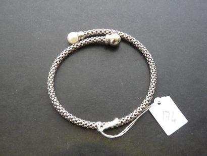 Bracelet semi-rigide ouvert en or gris 18K...