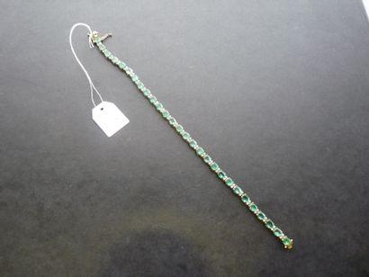 Bracelet ligne en or jaune 18K (750/oo) composé...