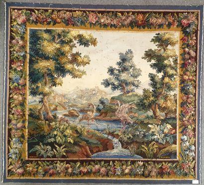 AUBUSSON, Atelier Bonjour, Tapisserie en laine figurant un paysage de plaine arborée...