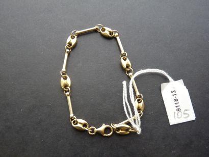 Bracelet en or 18K (750/oo) de deux tons...